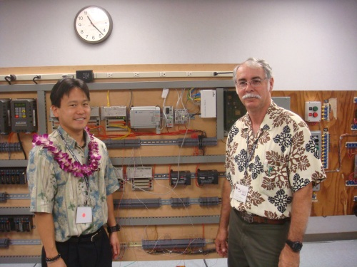 Rep. Jon Riki Karamatsu and a member of the IBEW.