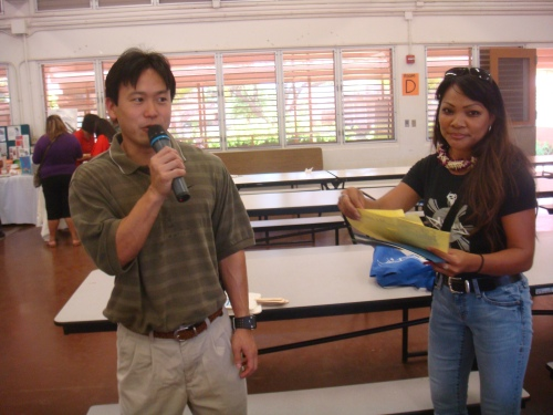 Rep. Jon Riki Karamatsu addressing the croww qith Betty Bartolome, DJ for Filipino Radio KPHI, 1130 AM/101.5/OC 882 FM
