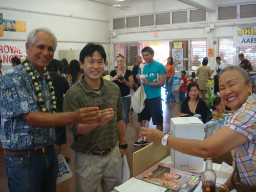 Sen. mike Gabbard, Rep. Jon Riki Karamatsu, and a business representative taking a shot of a healthy mango juice