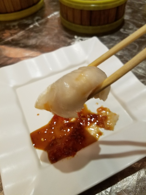 Grasped between my chopsticks is Jade Dynasty Seafood Restaurant's Signature Shrimp Dumpling.