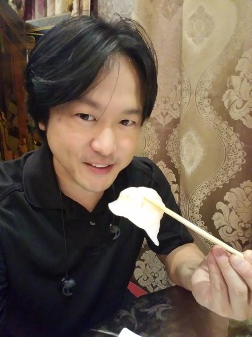 Grasped between my chopsticks is Jade Dynasty Seafood Restaurant's Signature Shrimp Dumpling.