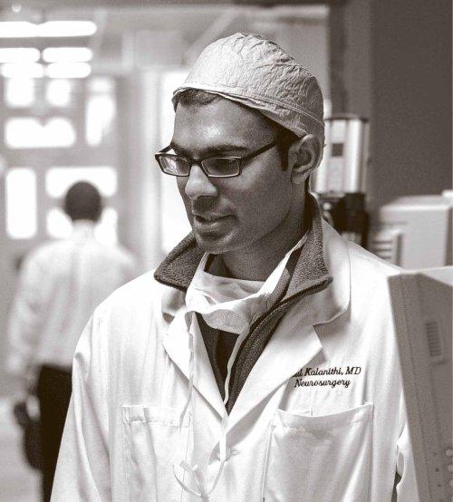 Dr. Paul Kalanithi, a neurosurgeon and neuroscientist, wearing his white coat.