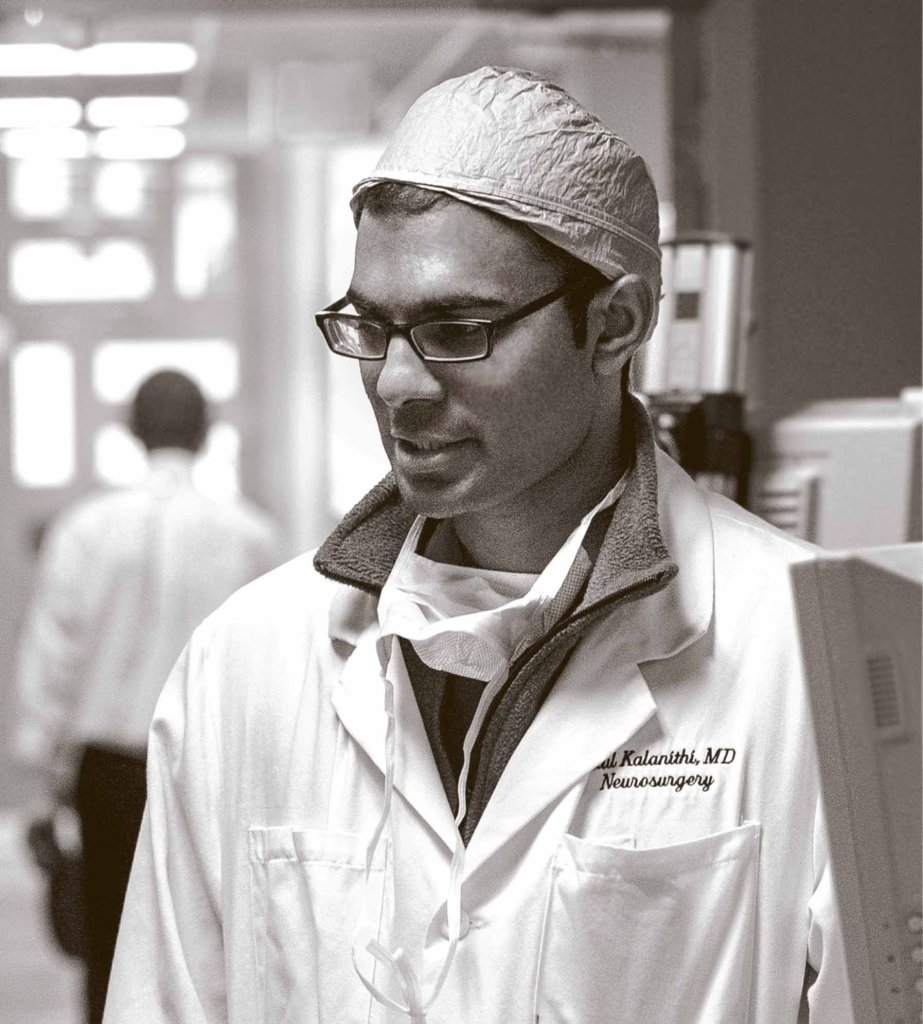 Dr. Paul Kalanithi, a neurosurgeon and neuroscientist, wearing his white coat.